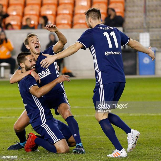 Stuart Holden celebrates with Clint Dempsey after he scored on a bicycle style kick during the Kick In For Houston Charity Soccer Match at BBVA...