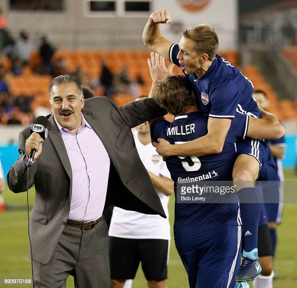 Stuart Holden jumps into the arms of Bode Miller after Miller made his shot during the Skillz Challenge as Fox Sports Soccer Analyst Fernando Fiore...