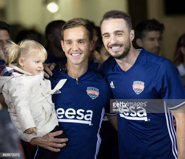 Stuart Holden left with daughter Kennedy and Euan Holden during the Kick In For Houston Charity Soccer Match at BBVA Compass Stadium on December 16...