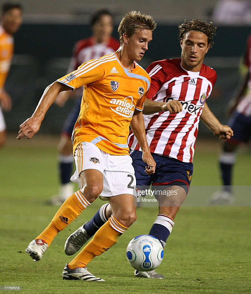 Stuart Holden #22 of Houston Dynamo in action against Laurent Merlin #10 of Chivas USA at The Home Depot Center October 20, 2007 in Carson, California. Chivas takes the regular season Western Conference title following a scoreless draw with Dynamo.