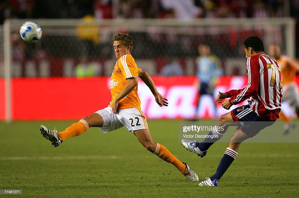 Stuart Holden #22 of Houston Dynamo tries to get a foot on the ball as Orlando Perez #77 of CD Chivas USA clears the ball in the first half during their MLS match at the Home Depot Center October 20, 2007 in Carson, California.