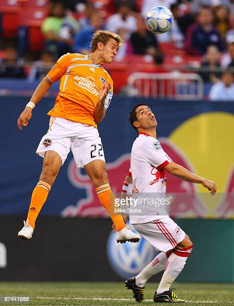 Stuart Holden of the Houston Dynamo and Juan Pablo Angel of the New York Red Bulls battle for the ball at Giants Stadium in the Meadowlands on May 16...