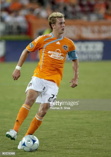 Stuart Holden of the Houston Dynamo dribbles the ball against the Seattle Sounders FC at Robertson Stadium on August 23 2009 in Houston Texas
