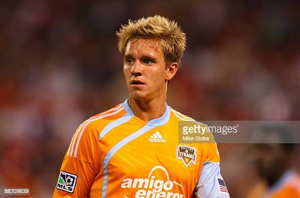 Stuart Holden of the Houston Dynamo looks on against the New York Red Bulls at Giants Stadium in the Meadowlands on May 16 2009 in East Rutherford...
