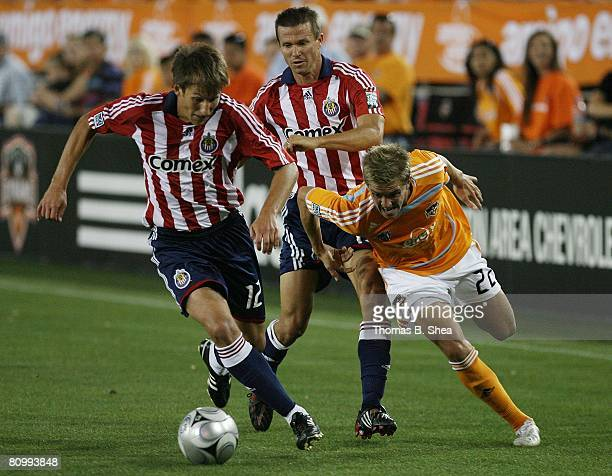 Stuart Holden of the Houston Dynamo loses the ball to Chris Pozniak and Jesse Marsch of Chivas USA on May 3 2008 at Robertson Stadium in Houston Texas