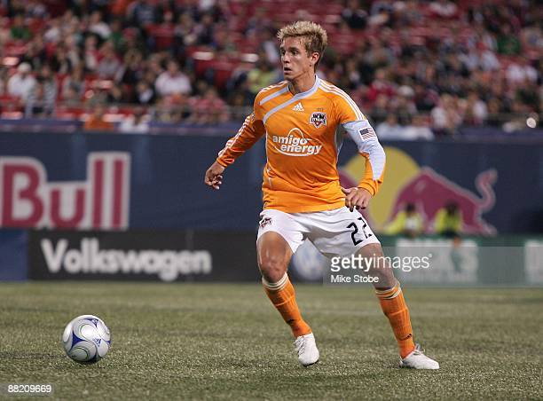 Stuart Holden of the Houston Dynamo plays the ball against the New York Red Bulls at Giants Stadium in the Meadowlands on May 16 2009 in East...