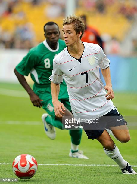 Stuart Holden of the United States with Sani Kaita of Nigeria during the Men's First Round Group B match between Nigeria and the United States at the...