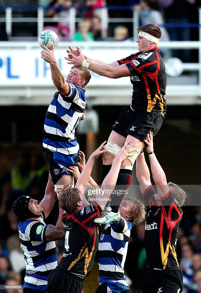 Stuart Hooper (2nd L) of Bath claims the ball in a lineout during the Amlin Challenge Cup match between Bath and Newport Gwent Dragons at Recreation Ground on October 19, 2013 in Bath, England.