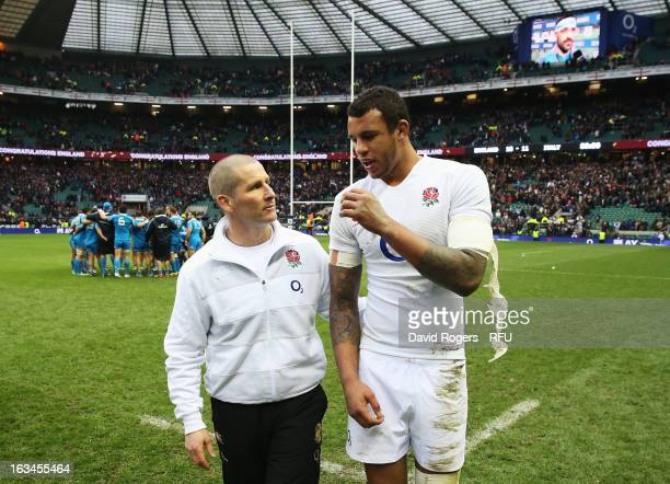 Stuart Lancaster head coach of England congratulates Courtney Lawes of England at the end of the match during the RBS Six Nations match England and...