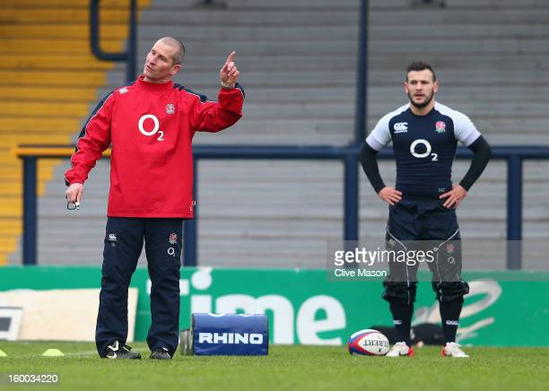 Stuart Lancaster of England in action as Danny Care of England looks on during a training session at the Headingley Carnegie Stadium on January 25...