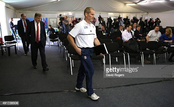 Stuart Lancaster the England head coach and RFU chief executive Ian Ritchie walk into the media room to face the media during the England conference...