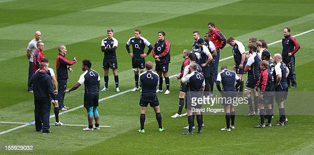 Stuart Lancaster, the England head coach issues instructions to his team during the England captain's run at Twickenham Stadium on November 9, 2012...