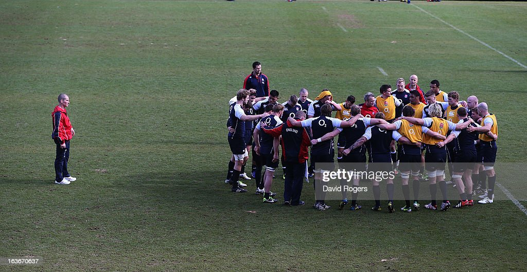 Stuart Lancaster, (L) the England head coach looks on as his team gather during the England training session at Pennyhill Park on March 14, 2013 in Bagshot, England.