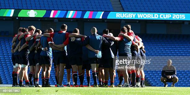 Stuart Lancaster, the England head coach looks on as his team gather during the England captain's run at the City of Manchester Stadium on October 9,...