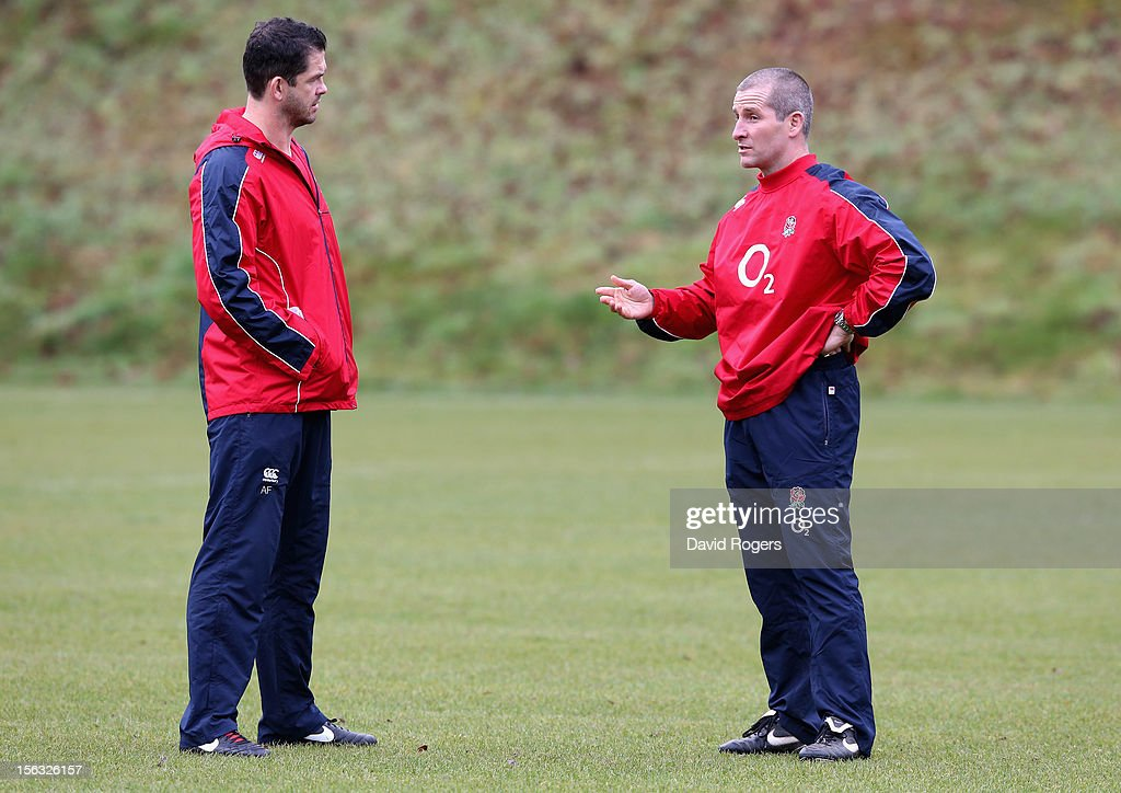 Stuart Lancaster, (R) the England head coach talks to backs coach Andy Farrell during the England training session held at Pennyhill Park on November 13, 2012 in Bagshot, England.