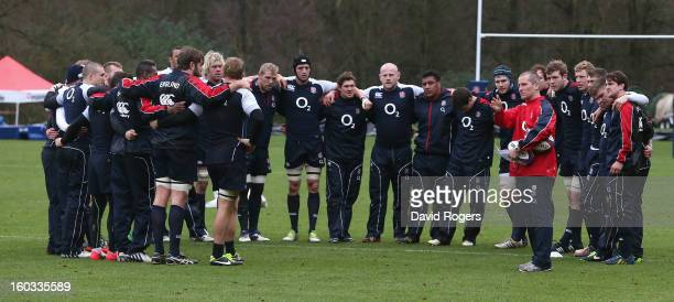 Stuart Lancaster the England head coach talks to his team during the England training session at Pennyhill Park on January 29 2013 in Bagshot England