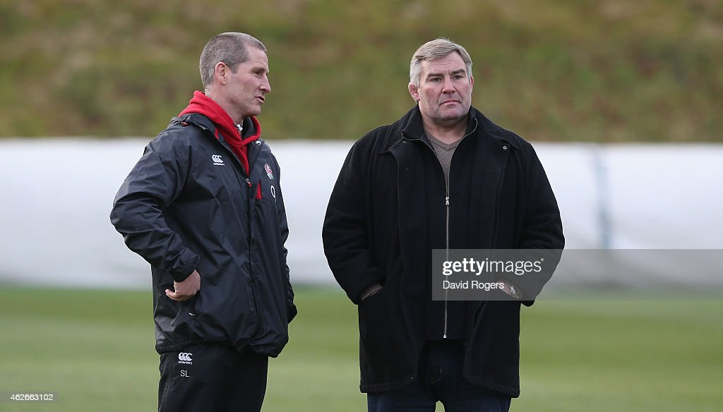 Stuart Lancaster (L) the England head coach talks to Jason Leonard during the England training session held at Pennyhill Park on February 2, 2015 in Bagshot, England.