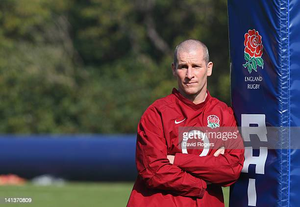 Stuart Lancaster the England head coach watches his team during the England training session held at Pennyhill Park on March 15 2012 in Bagshot...