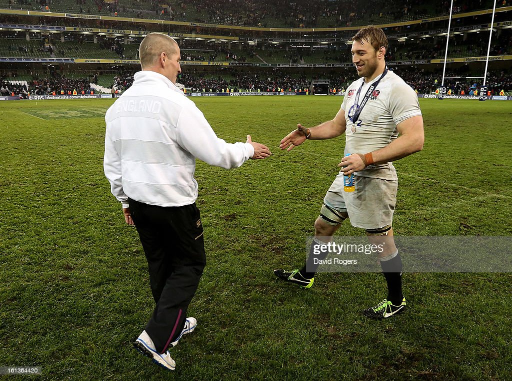 Stuart Lancaster the Head Coach of England shakes hands with England captain Chris Robshaw following their team's victory during the RBS Six Nations match between Ireland and England at Aviva Stadium on February 10, 2013 in Dublin, Ireland.