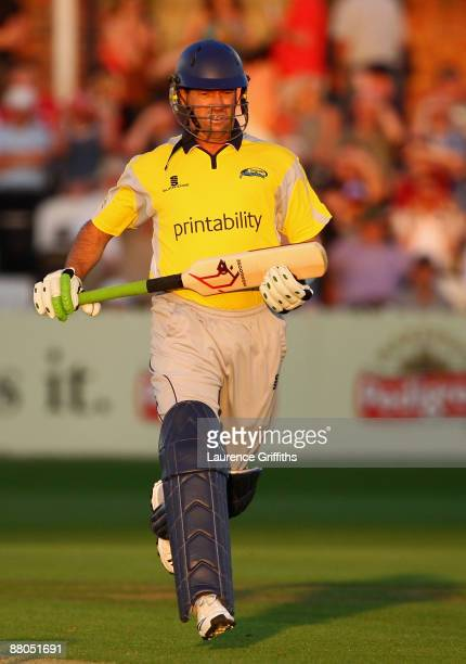 Stuart Law of Derbyshire hits out using the new mongoose bat with a long handle and shortened bat face during the Twenty20 Cup match between...