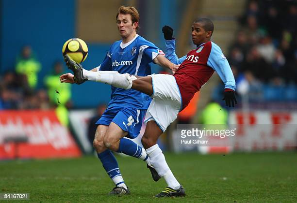 Stuart Lewis of Gillingham is tackled by Ashley Young of Aston Villa during the FA Cup sponsored by Eon third round match between Gillingham and...
