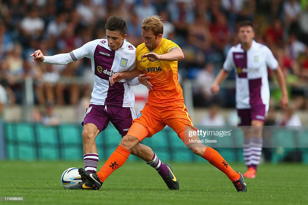 Stuart Lewis (R) of Wycombe Wanderers challenges Jack Grealish (L) of Aston Villa during the Pre Season Friendly match between Wycombe Wanderers and Aston Villa at Adams Park on July 20, 2013 in High Wycombe, England.