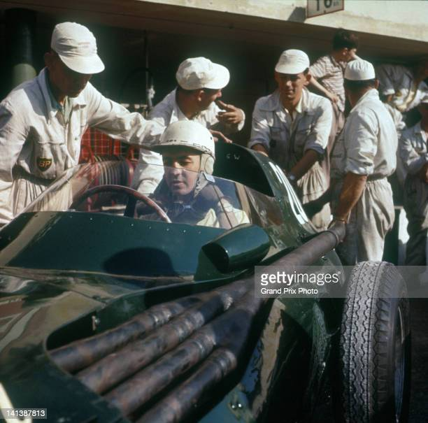 Stuart LewisEvans of Great Britain driver of the Vandervell Products Ltd Vanwall Straight4 in the pits during practice for the Italian Grand Prix on...