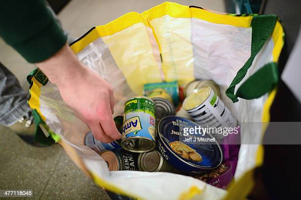 Stuart Little volunteer packs food at a food bank on March 7 2014 in Whitburn Scotland Charities based in Scotland are reporting that many families...