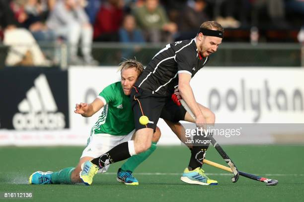 Stuart Loughrey of Ireland attempts to is tackle Christopher Ruhr of Germany during the Group B match between Germany and Ireland on day five of the...