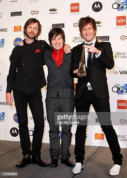 Stuart MacLeod Kav Temperley and Joel Quartermain of Eskimo Joe pose backstage in the Awards Room with the award for Single of the Year for 'Black...