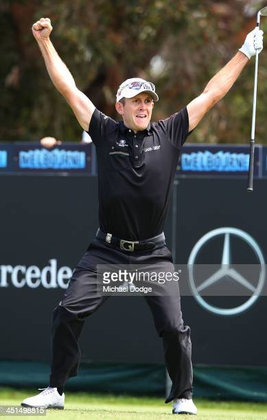 Stuart Manley of Wales celebrates making a holeinone on the 3rd tee during day three of the World Cup of Golf at Royal Melbourne Golf Course on...