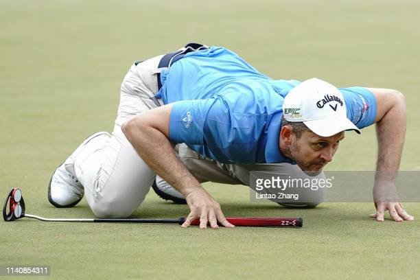 Stuart Manley of Wales lines up a putt on the 14th hole during the day two of the 2019 Volvo China Open at Genzon Golf Club on May 3 2019 in Chengdu...