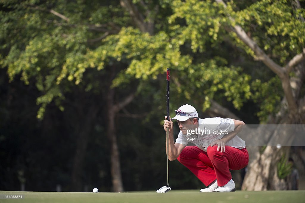 Stuart Manley of Wales lines up a shot on the final day of the Hong Kong Open at the Hong Kong Golf Club in Hong Kong on December 8, 2013.