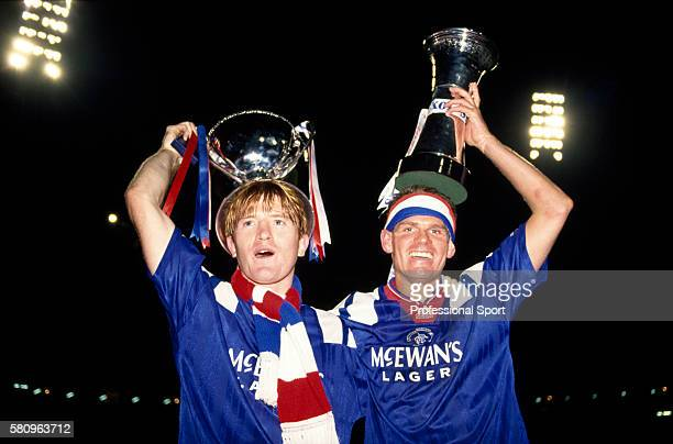 Stuart McCall and Ian Durrant of Glasgow Rangers celebrate with the trophies after the Skol Cup Final between Rangers and Aberdeen at Hampden Park in...