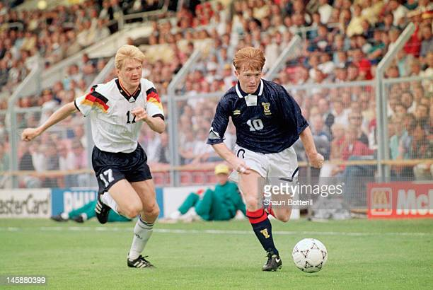 Stuart McCall of Scotland takes the ball past Stefan Effenberg of Germany during the UEFA European Championships 1992 Group 2 match between Scotland...