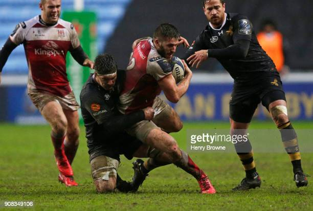 Stuart McCloskey of Ulster Rugby tackled by Guy Thompson of Wasps during the European Rugby Champions Cup match between Wasps and Ulster Rugby at...