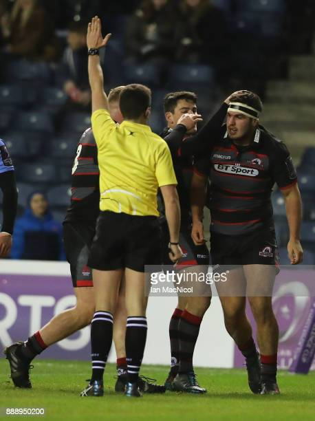 Stuart McInally of Edinburgh celebrates a after he breaks away to score the opening try during the European Rugby Challenge Cup match between...