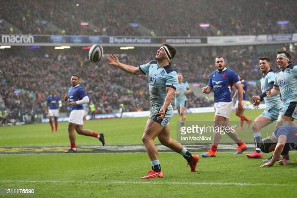 Stuart McInally of Scotland celebrates scoring his sides third try during the 2020 Guinness Six Nations match between Scotland and France at...