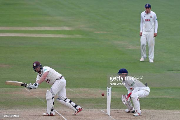 Stuart Meaker Of Surrey is bowled by Simon Harmer during the Essex v Surrey Specsavers County Championship Division One cricket match at the Cloudfm...