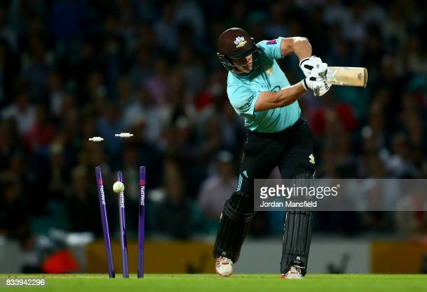 Stuart Meaker of Surrey is bowled out by David Payne of Gloucestershire during the NatWest T20 Blast match between Surrey and Gloucestershire at The...