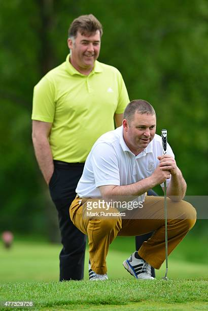 Stuart Morrison and Mike Keay of Tain Golf Club working together at 15th green during the Lombard Trophy - Scottish Qualifier at Crieff Golf Club on...