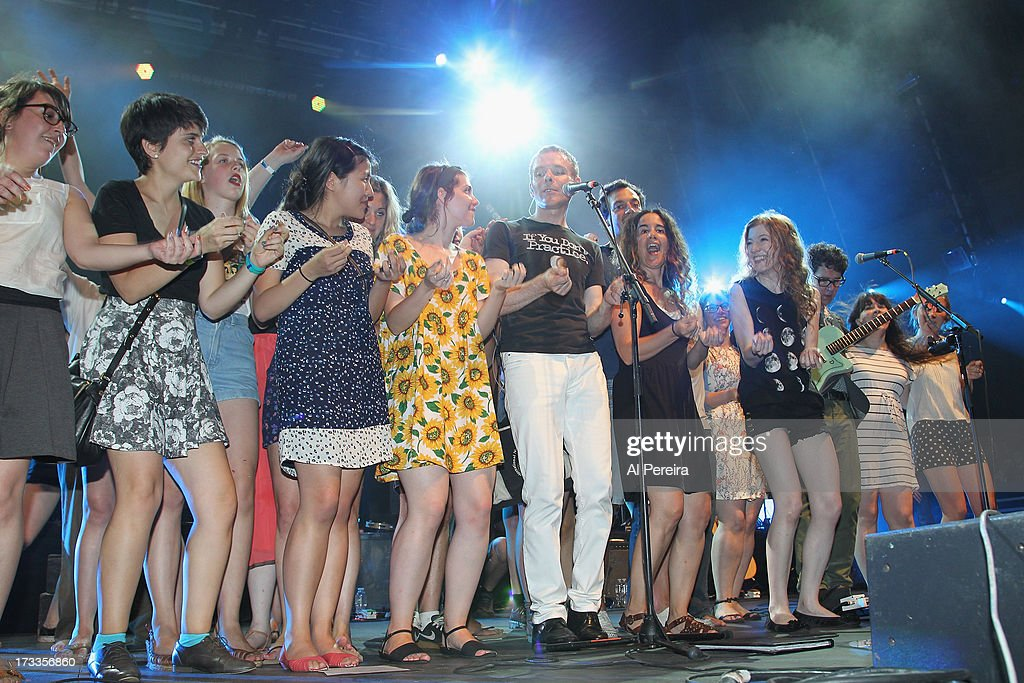 Stuart Murdoch of Belle And Sebastian invites fans onstage when Belle And Sebastian performs a concert to benefit Celebrate Brooklyn! at Prospect Park Bandshell on July 11, 2013 in the Brooklyn borough New York City.