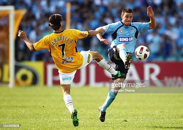 Stuart Musialik of Sydney competes with Zenon Caravella of Gold Coast during the round eight ALeague match between Sydney FC and Gold Coast United at...