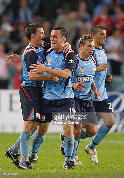Stuart Musialik of Sydney FC celebrates with team mates after scoring a goal during the round seven A-League match between Sydney FC and Queensland...