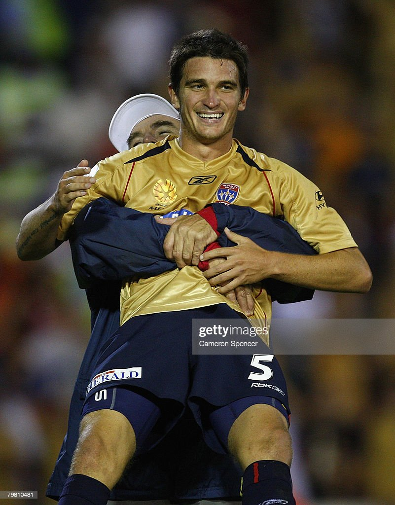 Stuart Musialik of the Jets is picked up by a Jets support staff member after winning the A-League Preliminary Final match between the Newcastle Jets and the Queensland Roar at EnergyAustralia Stadium on February 17, 2008 in Newcastle, Australia.