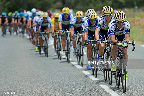 Stuart O'Grady of Australia drives the peloton for OricaGreenEdge as they successfully defend the overall race leader's yellow jersey for Simon...
