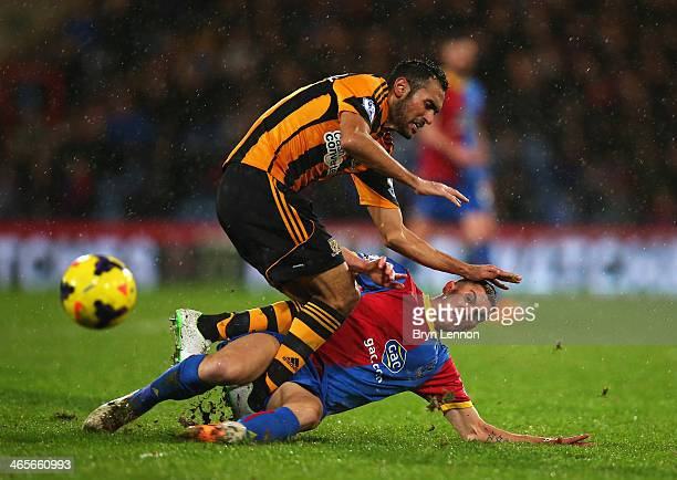 Stuart O'Keefe of Crystal Palace tackles Ahmed Elmohamady of Hull City during the Barclays Premier League match between Crystal Palace and Hull City...