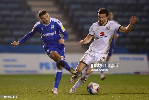 Stuart O'Keefe of Gillingham FC is challenged by Scott Fraser of Milton Keynes Dons during the Sky Bet League One match between Gillingham and Milton...