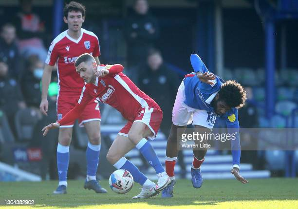 Stuart O'Keefe of Gillingham FC tackles Ellis Harrison of Portsmouth FC during the Sky Bet League One match between Portsmouth and Gillingham at...