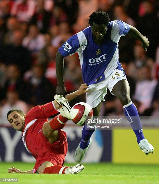 Stuart Parnaby of Middlesbrough challenges Benjamin Mwaruwari of Portsmouth during the Barclays Premiership match between Middlesbrough and...